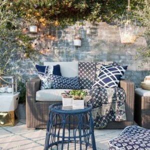 Colourful cushions and throws on outdoor furniture
