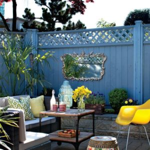 Painted fence surrounding outdoor patio