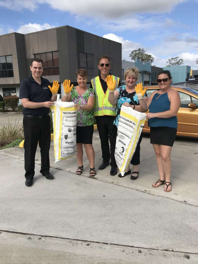 AOL staff clean up the streets - Australian Outdoor Living CEO Chris Taylor (centre) with staff from the company's QLD branch, Australian Outdoor Living.