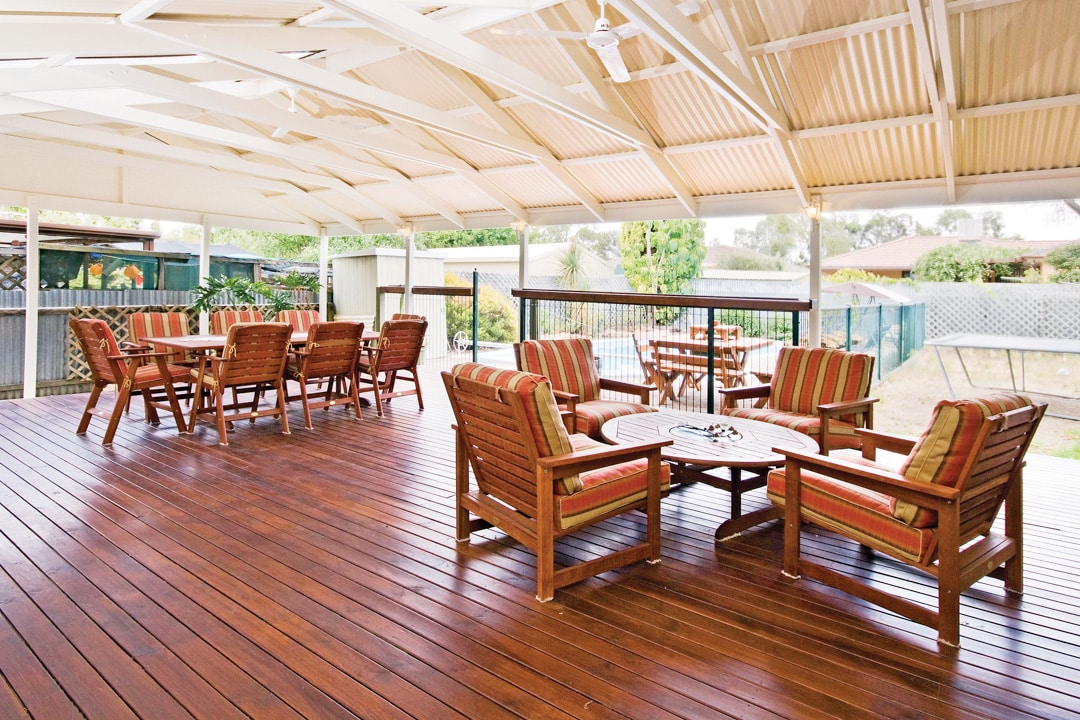 Timber decking: a great solution for a sloping backyard - A timber deck can provide a flat entertaining space on a sloping block, Australian Outdoor Living.